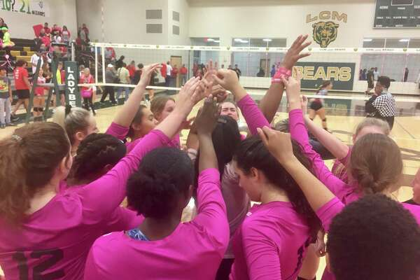 The Little Cypress-Mauriceville volleyball team huddles up after a 3-0 win over Bridge City on Friday night in Orange.