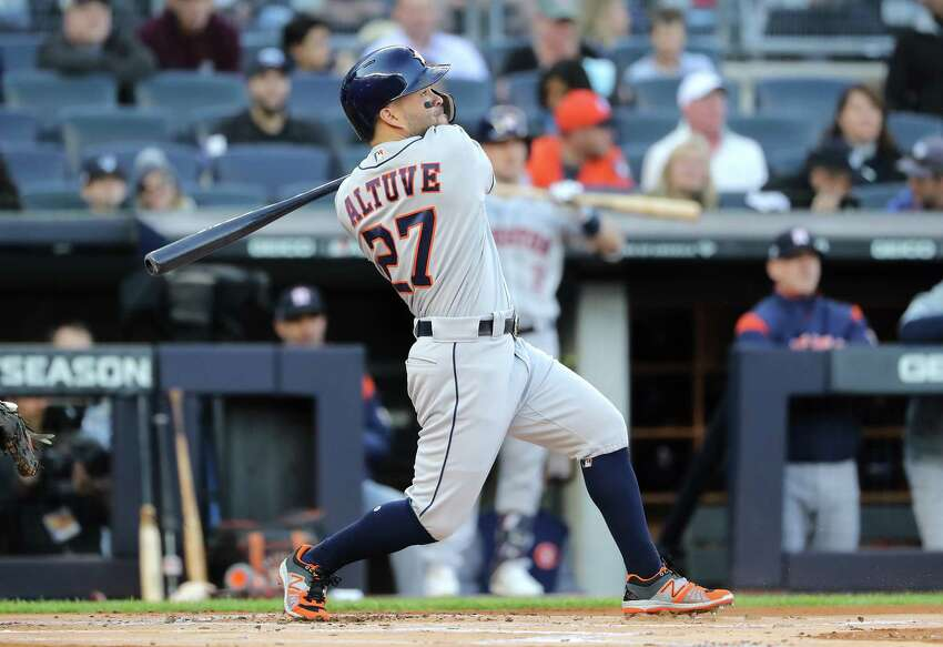 NEW YORK, NEW YORK - OCTOBER 15: Jose Altuve #27 of the Houston Astros hits a solo home run during the first inning against the New York Yankees in game three of the American League Championship Series at Yankee Stadium on October 15, 2019 in New York City. (Photo by Elsa/Getty Images)