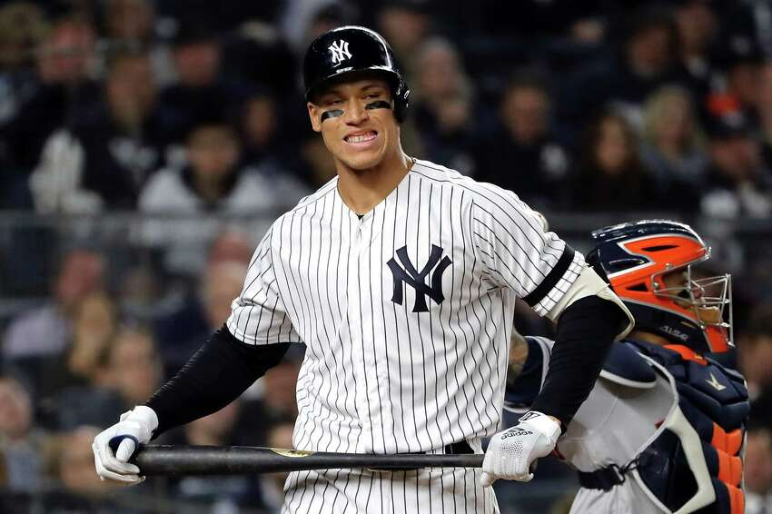NEW YORK, NEW YORK - OCTOBER 15: Aaron Judge #99 of the New York Yankees reacts after striking out during the seventh inning against the Houston Astros in game three of the American League Championship Series at Yankee Stadium on October 15, 2019 in New York City. (Photo by Elsa/Getty Images)