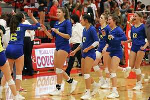 The Clemens volleyball team celebrates after defeating New Braunfels Canyon in girls volleyball in New Braunfels on Tuesday, Oct. 15, 2019. Clemens defeated Canyon, 3-2 in games, to earn a victory. (Kin Man Hui/San Antonio Express-News)