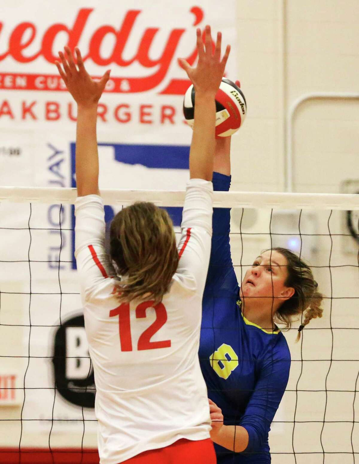 Clemens' Canada Buchanan (08) attempts a shot against New Braunfels Canyon's Angel Jones (12) in girls volleyball in New Braunfels on Tuesday, Oct. 15, 2019. Clemens defeated Canyon, 3-2 in games, to earn a victory. (Kin Man Hui/San Antonio Express-News)