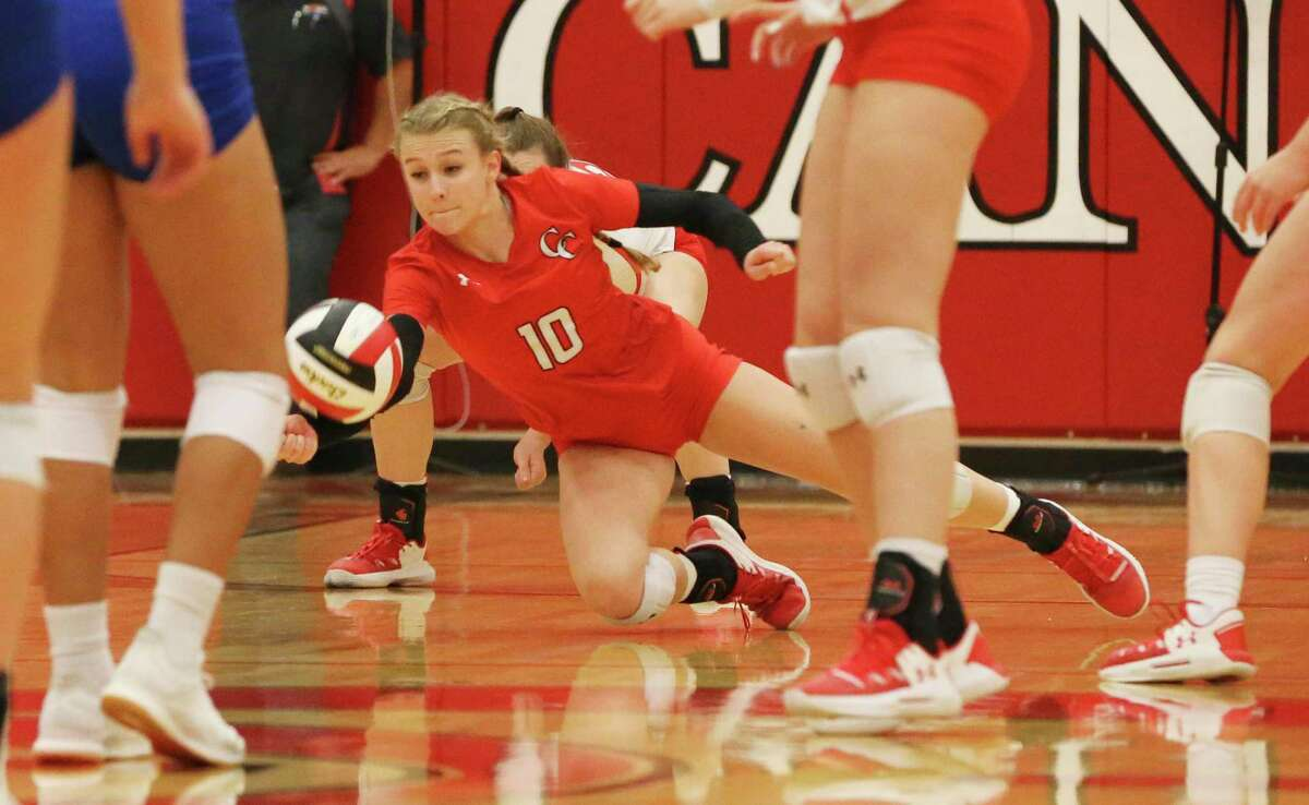 New Braunfels Canyon's Matti Theurer (10) dives to make a play against Clemens in girls volleyball in New Braunfels on Tuesday, Oct. 15, 2019. (Kin Man Hui/San Antonio Express-News)