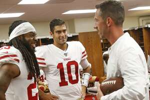 KANSAS CITY, MO - AUGUST 24: Richard Sherman #25, Jimmy Garoppolo #10 and Head Coach Kyle Shanahan of the San Francisco 49ers talk in the locker room prior to game against the Kansas City Chiefs at Arrowhead Stadium on August 24, 2019 in Kansas City, Miss