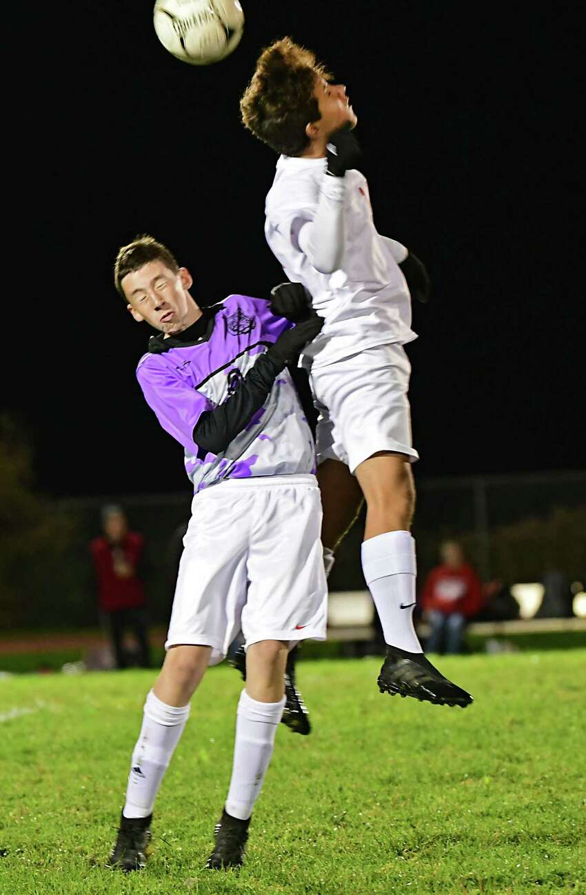 Tamarac's Alex Ednie, left, vies for the ball with Mechanicville's Andrew Kraszewski during a soccer game on Tuesday, Oct. 15, 2019 in Clums Corners, N.Y. (Lori Van Buren/Times Union)