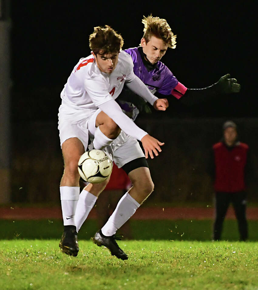 Mechanicville's Tyler Tesoriero, left, vies for the ball with Tamarac's Max Ali during a soccer game on Tuesday, Oct. 15, 2019 in Clums Corners, N.Y. (Lori Van Buren/Times Union)