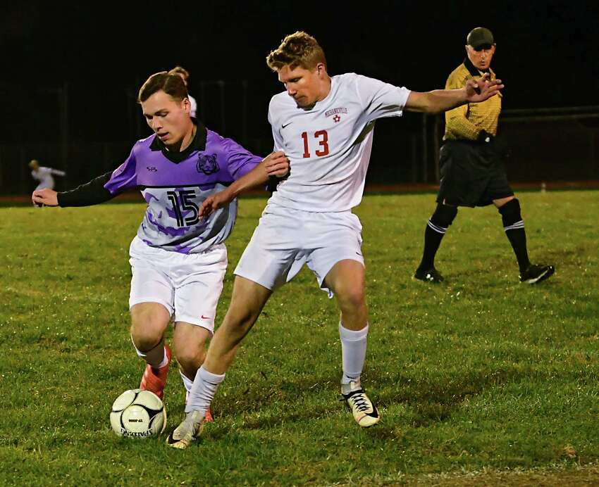 Tamarac's Andrew Minbiole, left, vies for the ball with Mechanicville's Sam Pisculli during a soccer game on Tuesday, Oct. 15, 2019 in Clums Corners, N.Y. (Lori Van Buren/Times Union)