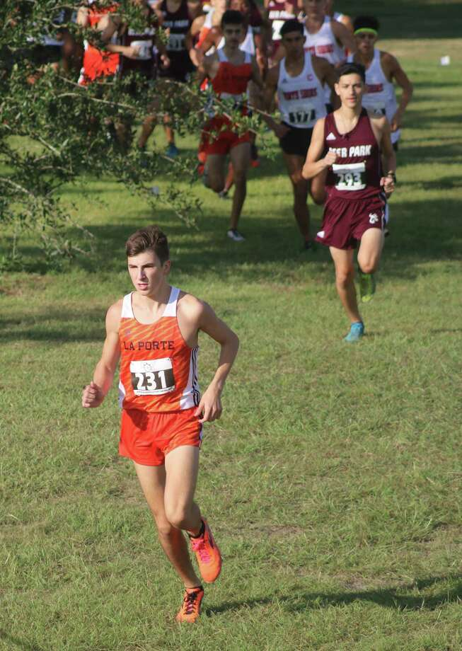 Ryan Schoppe grabs the early lead at the 2018 District 21-6A cross country championship. Schoppe will be the favorite to win Thursday morning's race, hoping to use it as a springboard to return to state where he just missed a state title last November. Photo: Robert Avery