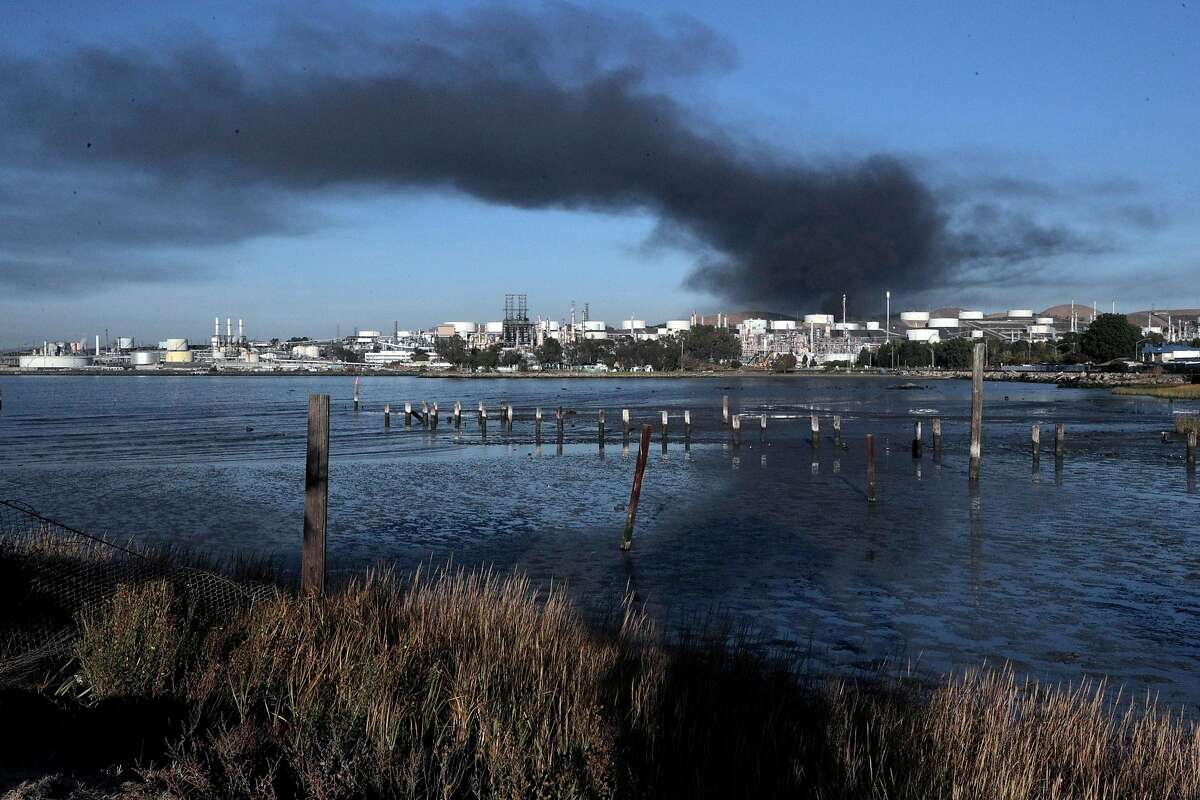 Thick black smoke rises into the air as seen from D & R Marine in Rodeo after an explosion and fire at the NuStar Energy facility in Crockett, Calif., on Tuesday, October 15, 2019. Interstate 80 in the vicinity was shut down for hours causing gridlock on surrounding nearby streets and nearby residents were asked to shelter in place as thick black smoke possibly containing hazardous compounds filled the air in the area.