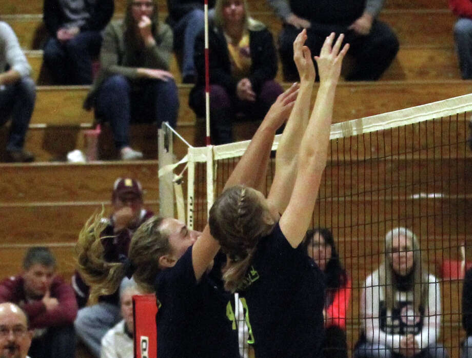 The Bad Axe varsity volleyball team battled Reese on Tuesday night. Photo: Mark Birdsall/Huron Daily Tribune