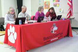 Benzie Central board members go over reports during their meeting on Oct. 14. (Photo/Robert Myers)