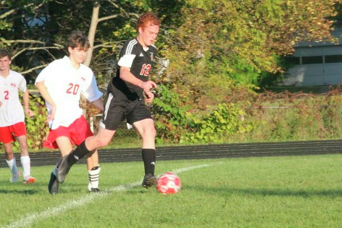 Reed City's Ethan Maddox surges down the field against Kent City. (Herald Review photo/John Raffel)