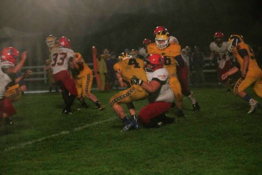 Evart's Justin O'Dell (4) is stopped by the Lake City defense in Friday's game. (Herald Review photo/John Raffel)