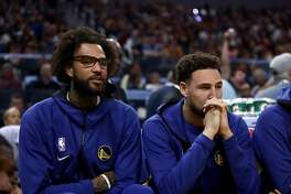 SAN FRANCISCO, CALIFORNIA - OCTOBER 05: Injured Willie Cauley-Stein #2 and Klay Thompson #11 sit on the bench during their game against the Los Angeles Lakers at Chase Center on October 05, 2019 in San Francisco, California. NOTE TO USER: User expressly acknowledges and agrees that, by downloading and or using this photograph, User is consenting to the terms and conditions of the Getty Images License Agreement. (Photo by Ezra Shaw/Getty Images)