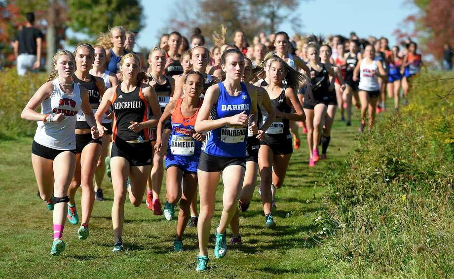Darien sophomore Mairead Clas leads a pack of runners around a turn during the FCIAC Cross Country Championships at Waveny Park in New Canaan on Tuesday. Photo: Matthew Brown / Hearst Connecticut Media / Stamford Advocate
