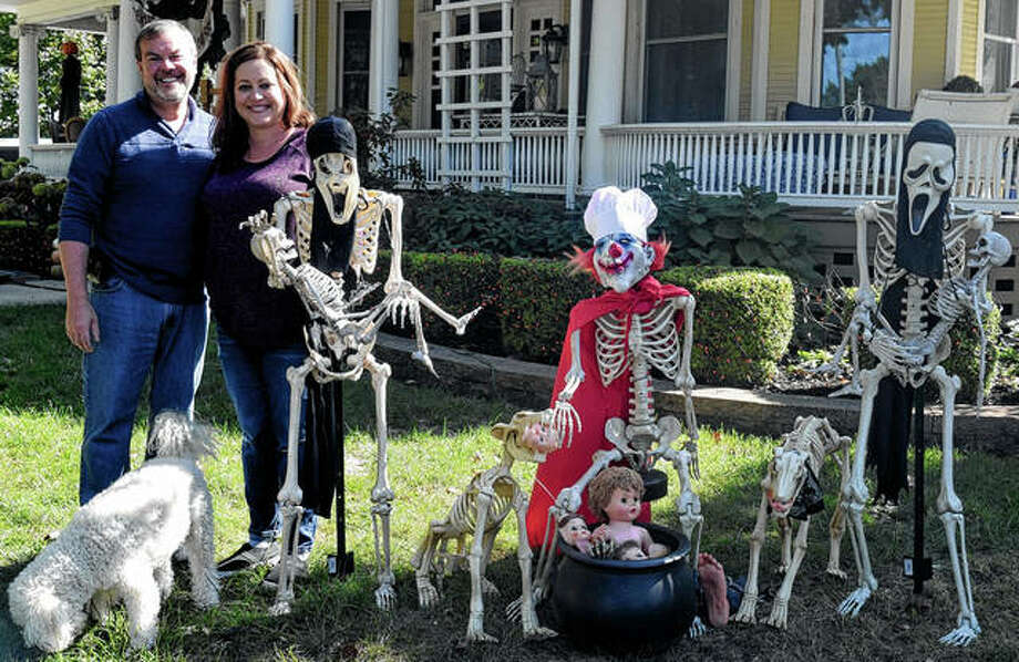 Jeff and Crissie Olejnik stand with their latest skeleton display Monday in front of their home at West State and South Webster streets. Photo: Samantha McDaniel-Ogletree | Journal-Courier