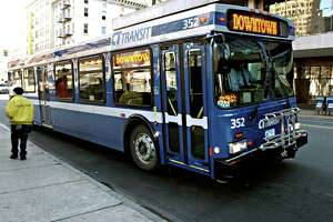 CITBUS-12/30/03-Mia New busses have hit the streets of new Haven. Sporting a bright blue coat of paint, and bike racks on the front, approx. 20 of these buses have made their debut. Phoot by Mia M Malafronte file;mIa0109d(1398)