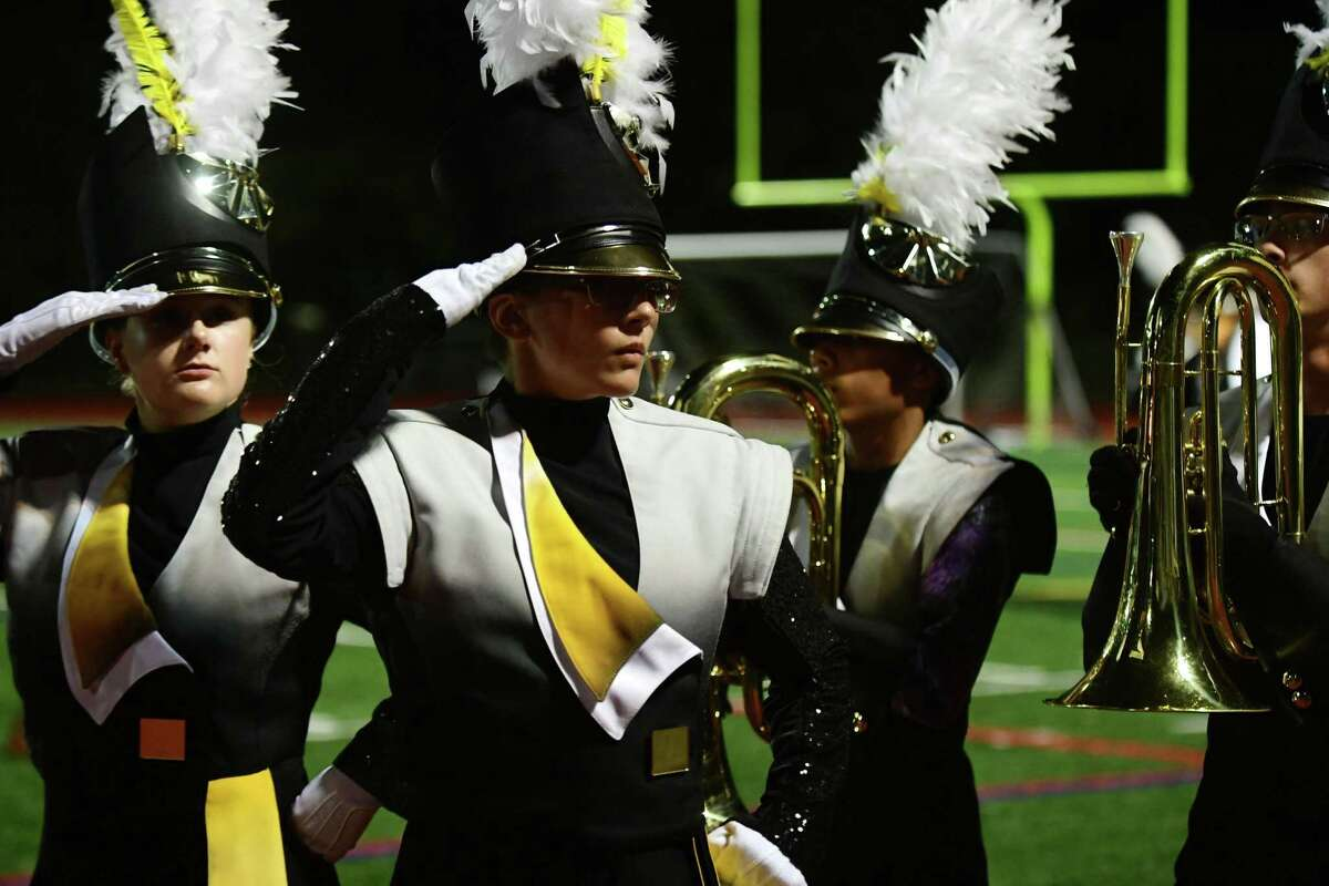 Trumbull High School Marching Bands perform their halftime field show as Norwalk High School hosts The Cavalcade of Bands Saturday, October 12, at the school in Norwalk.