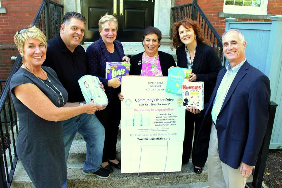 State Representatives Laura Devlin and David Rutigliano, Trumbull's First Selectman Vicky Tesoro, Beth Stoller from Trumbull Rotary, Janine Wolfe from Trumbull Community Women and Vincent Fini from Trumbull Rotary with their donations of diapers. Photo: Contributed Photo