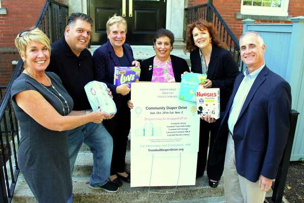 State Representatives Laura Devlin and David Rutigliano, Trumbull's First Selectman Vicky Tesoro, Beth Stoller from Trumbull Rotary, Janine Wolfe from Trumbull Community Women and Vincent Fini from Trumbull Rotary with their donations of diapers.