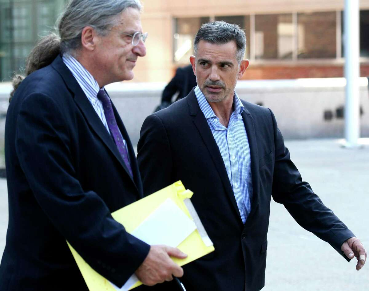 Fotis Dulos, right, walks with his attorney Norm Pattis after appearing at the Connecticut Superior Court in Stamford, Conn., Monday, Sept. 23, 2019.