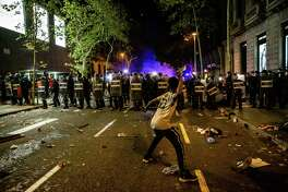 Demonstrators clash with police during a protest against the jailing of Catalan separatists at the delegation of the Spanish Government in Barcelona, Spain, on Oct. 15, 2019.