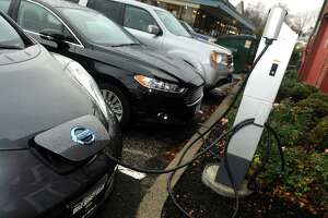 A couple of cars plugged into the EV Charging Station behind Ridgefield Town Hall, in Ridgefield.