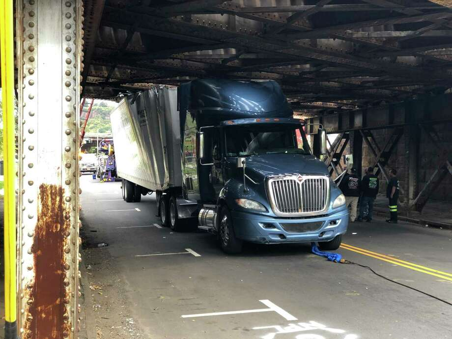 A truck became stuck under a bridge at 470 James St. in New Haven Wednesday morning. Photo: Ben Lambert / Hearst Connecticut Media