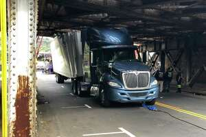 A truck became stuck under a bridge at 470 James St. in New Haven Wednesday morning.
