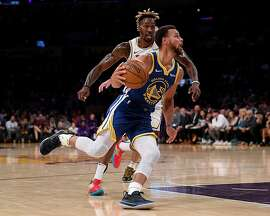 LOS ANGELES, CALIFORNIA - OCTOBER 14:  Stephen Curry #30 of the Golden State Warriors drives to the basket past Dwight Howard #39 of the Los Angeles Lakers during the first half at Staples Center on October 14, 2019 in Los Angeles, California. (Photo by Harry How/Getty Images)