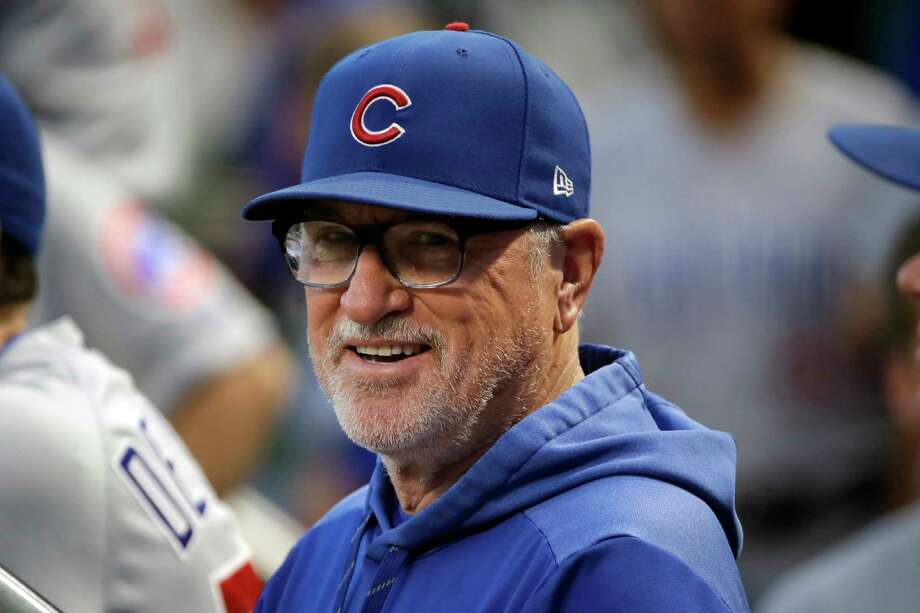 FILE - In this Sept. 25, 2019, file photo, then-Chicago Cubs manager Joe Maddon stands in the dugout before a baseball game against the Pittsburgh Pirates, in Pittsburgh. Joe Maddon has agreed to become the Los Angeles Angels' manager. Maddon and the Angels agreed to terms Wednesday, Oct. 16, 2019, on a deal to reunite the veteran manager with the organization where he spent the first three decades of his baseball career. (AP Photo/Gene J. Puskar, File) Photo: Gene J. Puskar, Associated Press / Copyright 2019 The Associated Press. All rights reserved