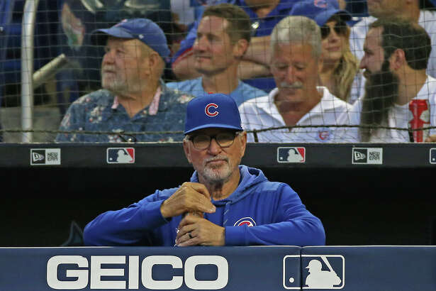 Chicago Cubs manager Joe Maddon looks on from the dugout during action against the Miami Marlins at Marlins Park in Miami on April 16, 2019.