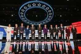 2020 Democratic presidential candidates, from left: Rep. Tulsi Gabbard, D-Hawaii; Tom Steyer, co-founder of NextGen Climate Action Committee; Sen. Cory Booker, D-N.J.; Sen. Kamala Harris, D-Calif.; Sen. Bernie Sanders, I-Vt.; Former vice president Joe Biden; Sen. Elizabeth Warren, D-Mass.; Pete Buttigieg, mayor of South Bend, Indiana; Andrew Yang, founder of Venture for America; Beto O'Rourke, former representative from Texas; Sen. Amy Klobuchar, D-Minn.; and Julian Castro, former secretary of Housing and Urban Development, during the Democratic presidential candidate debate in Westerville, Ohio, on Oct. 15, 2019.