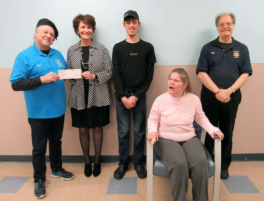 Ansonia Knights of Columbus Council 10537, assisted by Council 28, presented a Tootsie Roll drive check for $2,097.89 to St. Vincent's Special Needs Services' Dianne Auger. St Vincent's serves people with intellectual disabilities. From left are Joe Cassetti, Grand Knight at Holy Rosary Church, Dianne Auger, Edward Andrejko and Renee Sojka and Robert Laccone, Tootsie Roll drive committee member. Photo: Contributed Photo /