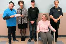 Ansonia Knights of Columbus Council 10537, assisted by Council 28, presented a Tootsie Roll drive check for $2,097.89 to St. Vincent's Special Needs Services' Dianne Auger. St Vincent's serves people with intellectual disabilities. From left are Joe Cassetti, Grand Knight at Holy Rosary Church, Dianne Auger, Edward Andrejko and Renee Sojka and Robert Laccone, Tootsie Roll drive committee member.