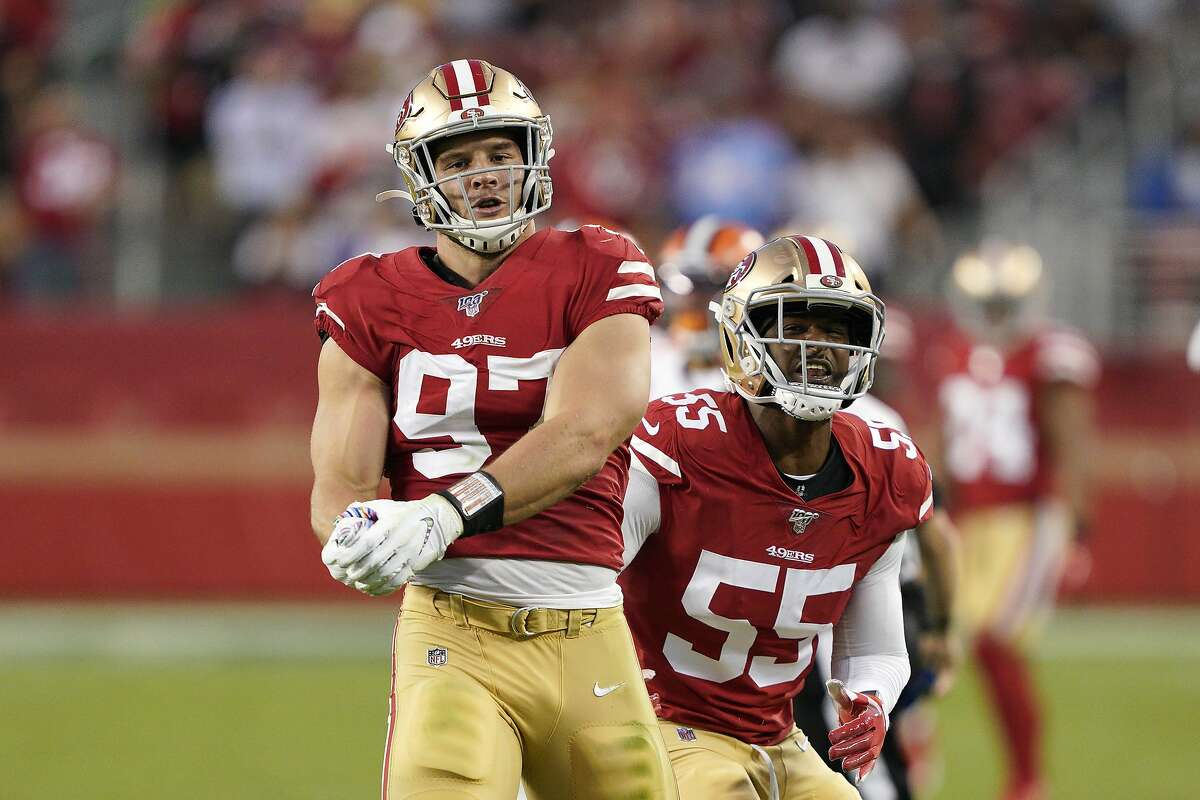 San Francisco 49ers defensive end Nick Bosa (97) and defensive end Dee Ford (55) celebrate against the Cleveland Browns during an NFL football game in Santa Clara, Calif., Monday, Oct. 7, 2019. (AP Photo/Tony Avelar)