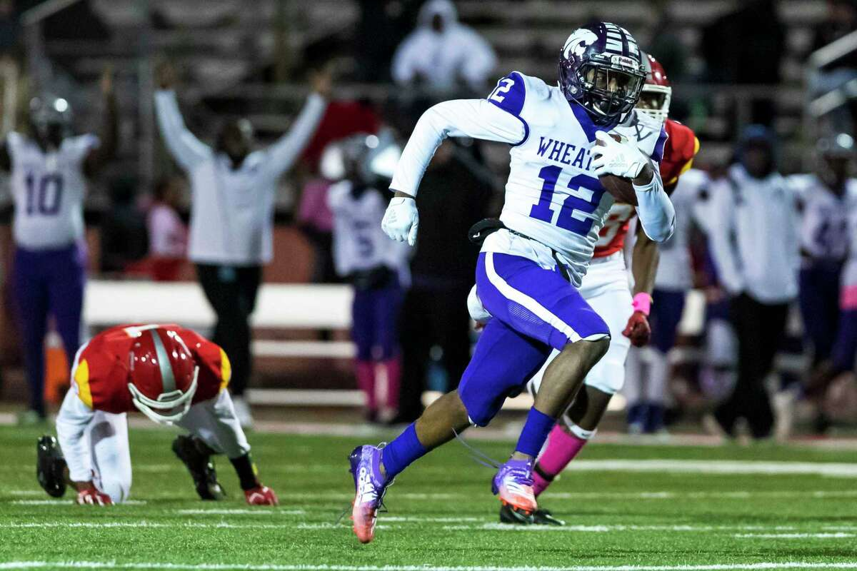Wheatley receiver Colbi Clark (12) catches a 35-yard pass for a touchdown in the second half of a high school football game Friday, Oct 11, 2019, in Stafford, Texas.