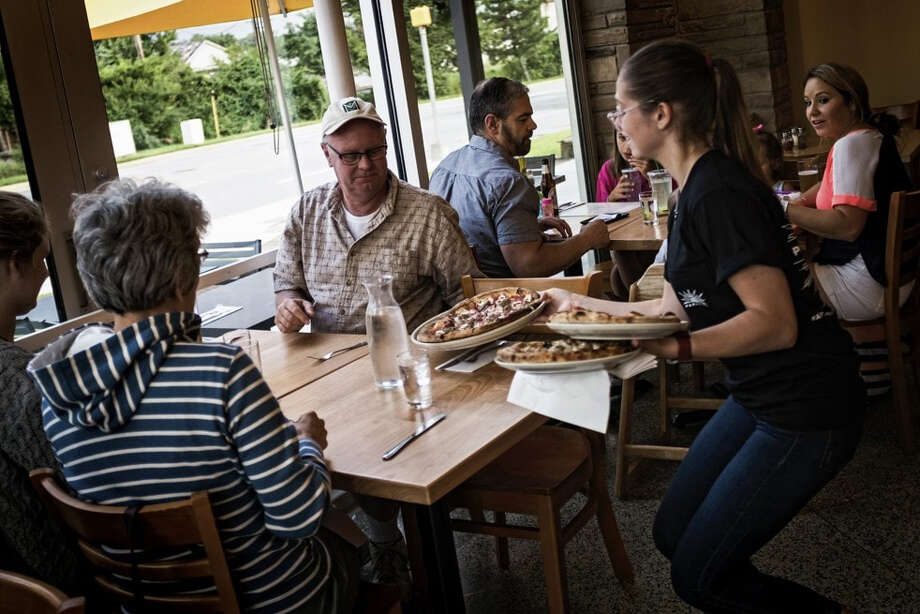 Diners at Pizzeria Paradiso in Hyattsville, Md., a suburb of Washington, D.C. Photo: Photo For The Washington Post By J. Lawler Duggan / The Washington Post