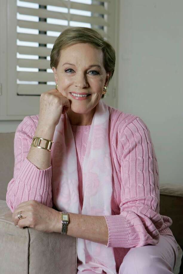 """FILE - This May 5, 2007 file photo shows actress and singer Julie Andrews poses in Los Angeles. Andrews released a memoir, """"Home Work: A Memoir of My Hollywood Years,"""" which hits shelves on Oct. 15, 2019. (AP Photo/Chris Carlson, File) / AP2007"""