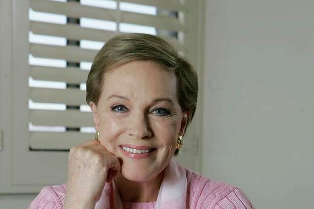 "FILE - This May 5, 2007 file photo shows actress and singer Julie Andrews poses in Los Angeles. Andrews released a memoir, ""Home Work: A Memoir of My Hollywood Years,"" which hits shelves on Oct. 15, 2019. (AP Photo/Chris Carlson, File)"
