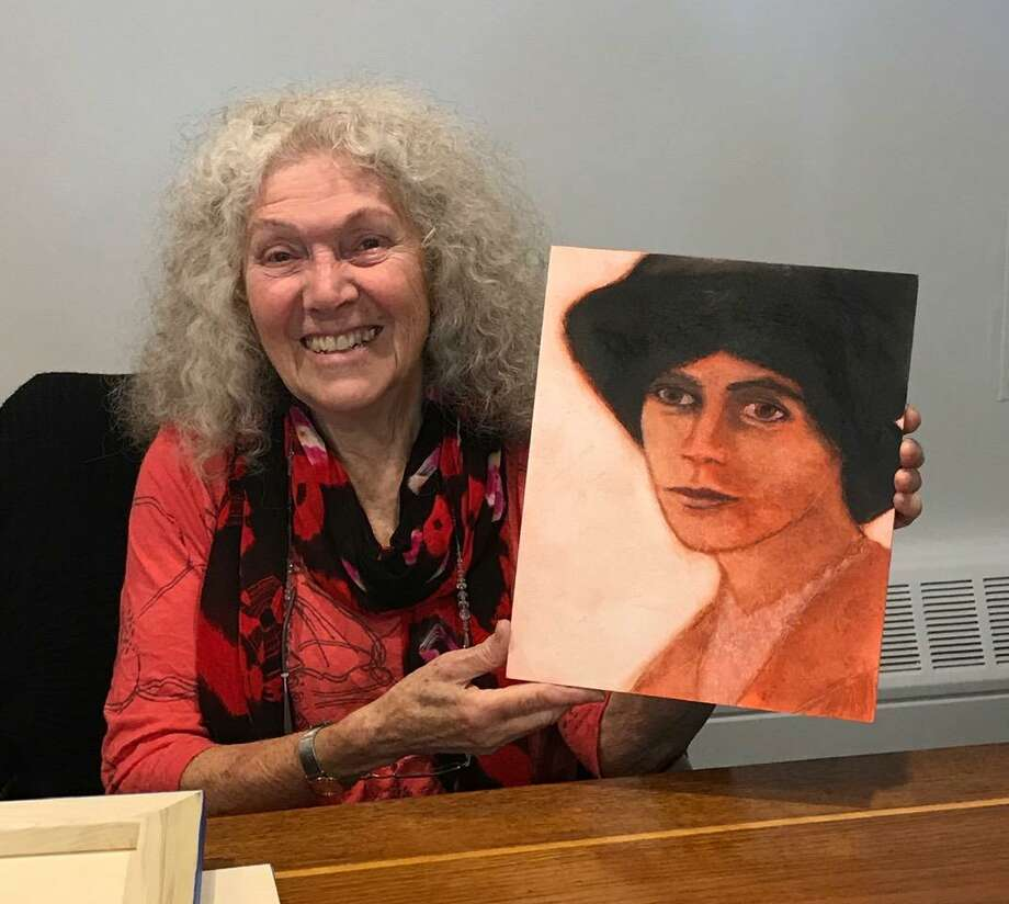 Artist Suzanne Benton with her portrait of Alice Paul. Photo: Tina Sarno / Contributed Photo