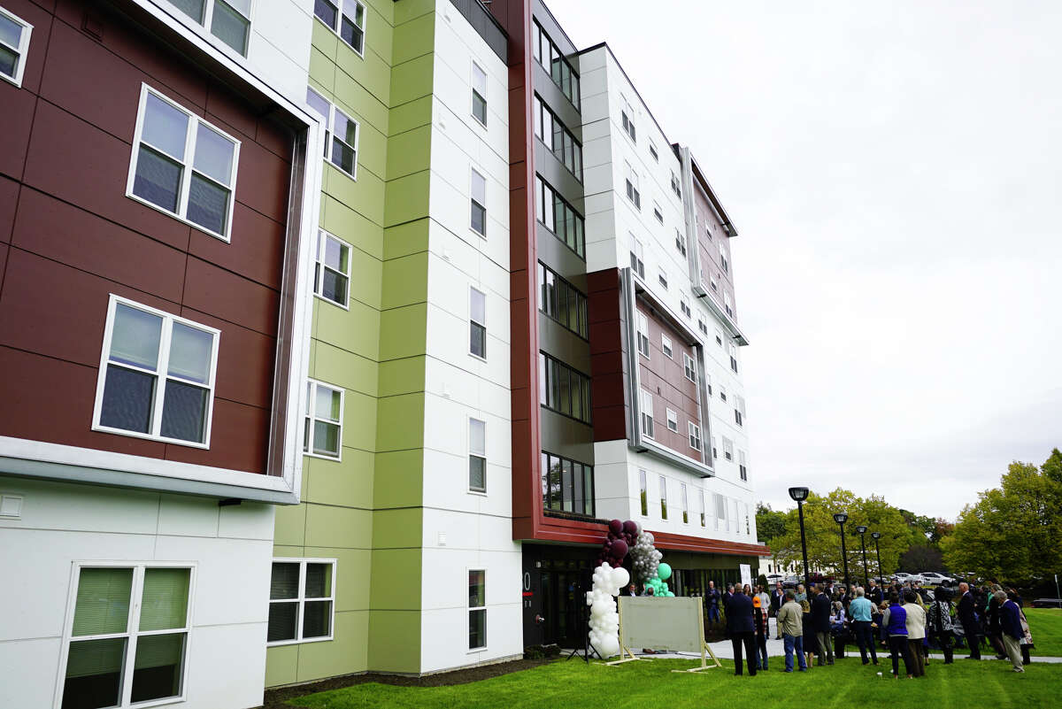 People gather for a ribbon cutting event for affordable housing at 280 North on Wednesday, Oct. 16, 2019, in Albany, N.Y. 280 North is the second phase of the redevelopment of the site where Ida Yarbrough Homes once stood. (Paul Buckowski/Times Union)