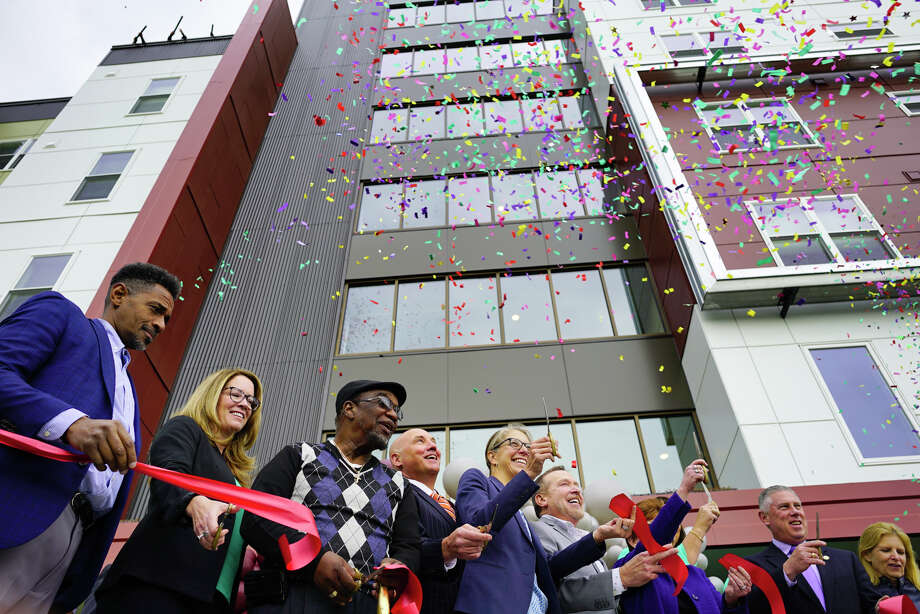 Elected officials and community leaders celebrate at a ribbon cutting event for affordable housing at 280 North on Wednesday, Oct. 16, 2019, in Albany, N.Y. 280 North is the second phase of the redevelopment of the site where Ida Yarbrough Homes once stood.   (Paul Buckowski/Times Union) Photo: Paul Buckowski, Albany Times Union / (Paul Buckowski/Times Union)