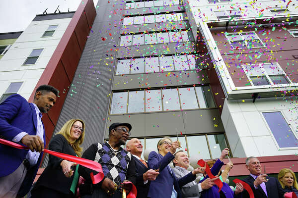 Elected officials and community leaders celebrate at a ribbon cutting event for affordable housing at 280 North on Wednesday, Oct. 16, 2019, in Albany, N.Y. 280 North is the second phase of the redevelopment of the site where Ida Yarbrough Homes once stood. (Paul Buckowski/Times Union)