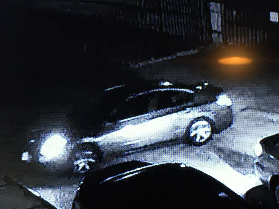 Police are trying to identify three suspects. One in a light-colored shirt, seen in the surveillance assaulting the male victim; another suspect ran after the victim's wife, and a getaway driver believed to be driving a Nissan Maxima. Photo: Houston Police Department