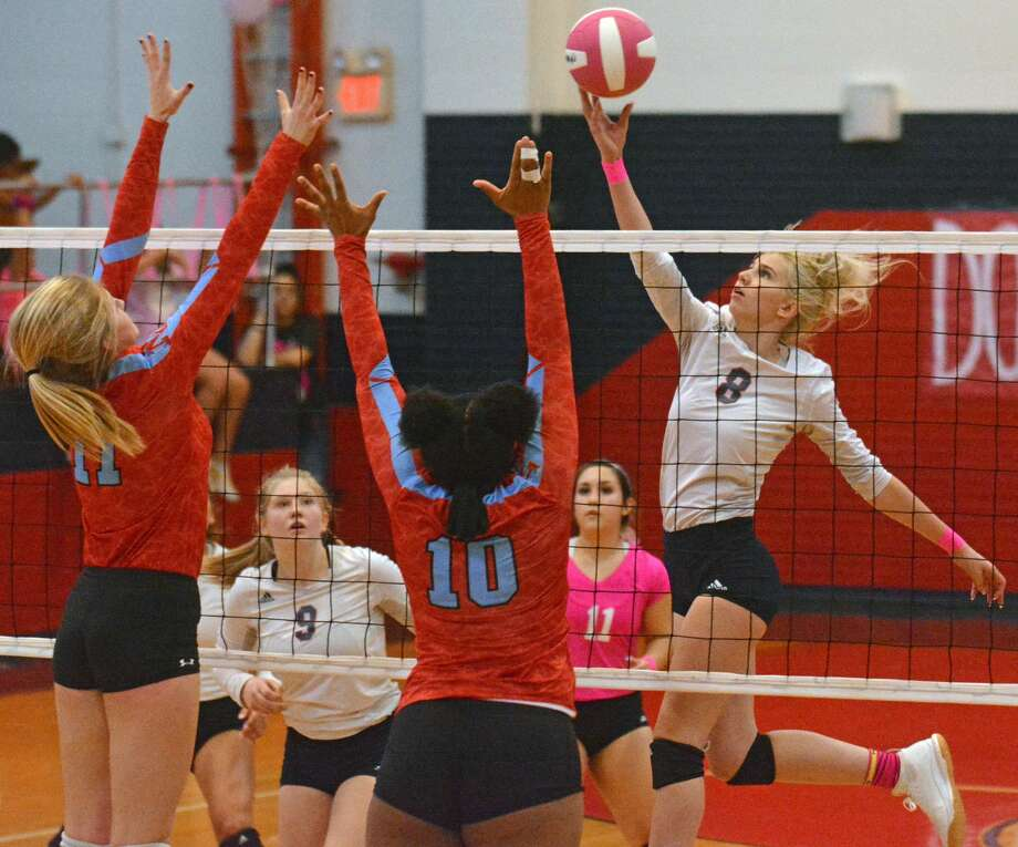 Plainview's Lexie Bennett attempts to tap the ball away from Lubbock Monterey defenders Khristian Butler (10) and Madeline Stephens during their District 3-5A volleyball match on Tuesday in the Dog House. Also pictured for Plainview are Haley Curtis (9) and Emily Sigala (11). Photo: Nathan Giese/Planview Herald