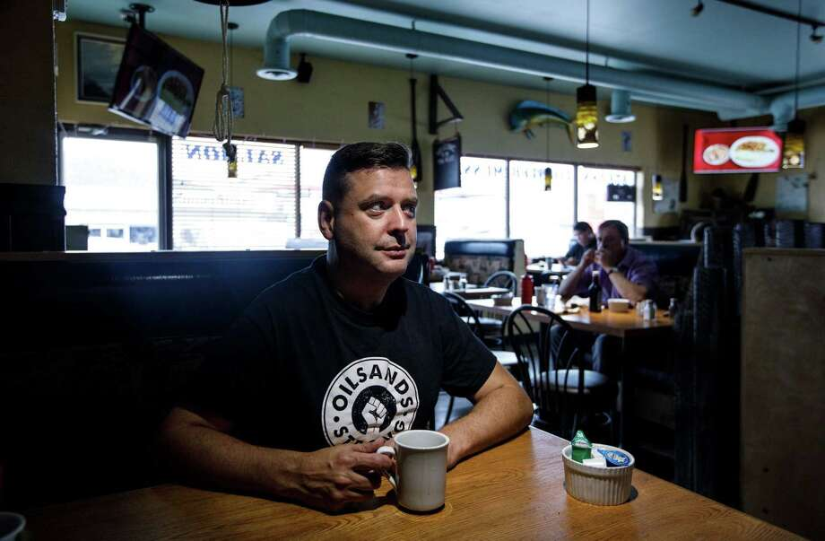 Robbie Picard, founder of Oil Sands Strong, sits for a photograph at a diner in Fort McMurray, Alberta, on Sept. 24, 2019. Photo: Bloomberg Photo By Jason Franson. / The Washington Post