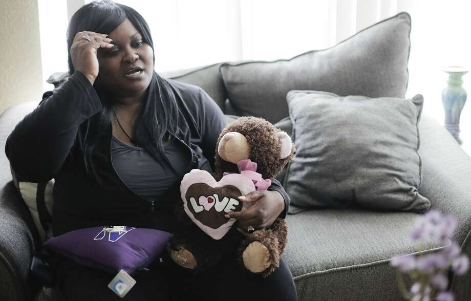 Jessica Byas-Lurgio holds a teddy bear that belonged to her half-sister. Byas-Lurgio had custody of the little girl when she was severely burned. A doctor accused Byas-Lurgio of intentionally burning the child. Photo: Elizabeth Conley/Staff Photographer