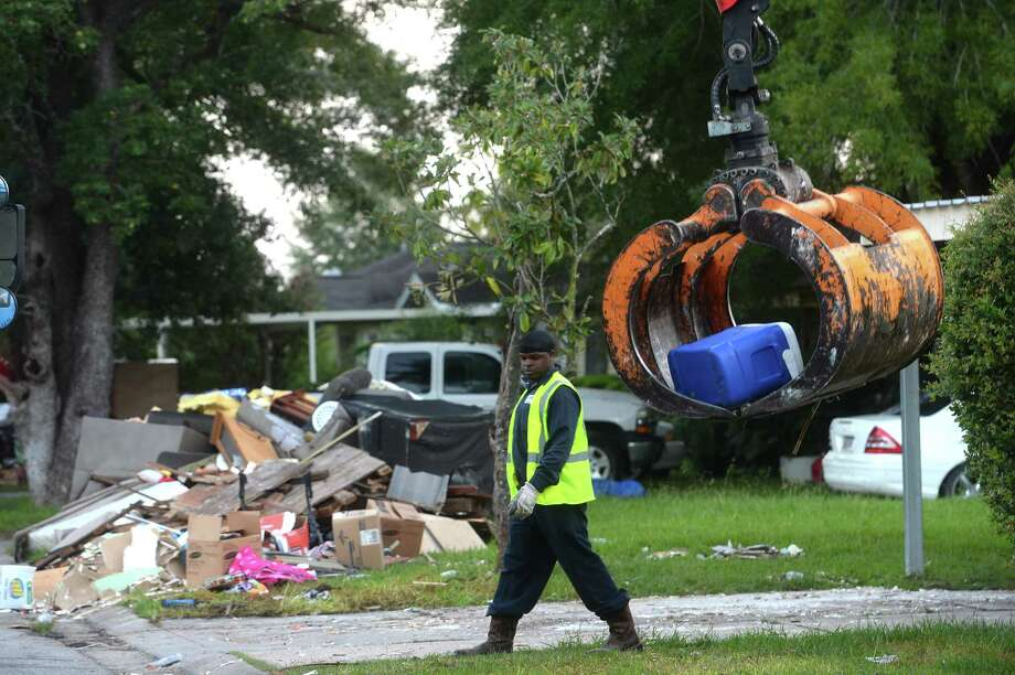 Crews with the City of Beaumont Solid Waste blanketed the neighborhood surrounding Fehl - Price Elementary early Saturday morning as they continue the large debris pick-up from homes and businesses gutted after flooding during Imelda last week. Photo taken Saturday, September 28, 2019 Kim Brent/The Enterprise Photo: Kim Brent / Kim Brent/The Enterprise / BEN