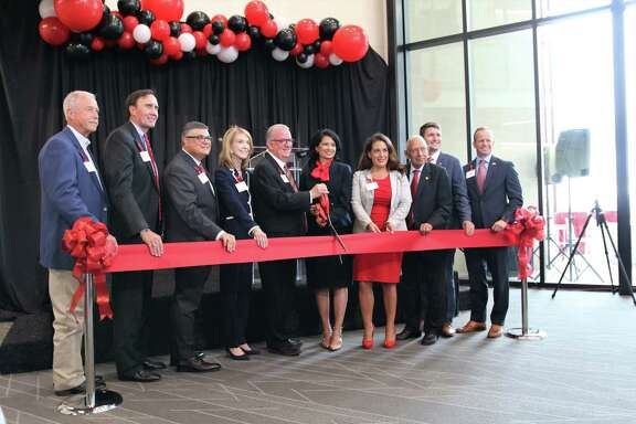 From left: Katy Mayor Bill Hastings, U.S. Rep. Pete Olson, Associate Vice President Jay Neal of UH at Katy, UH System Vice Chancellor Paula M. Short, UH-V President Robert Glenn, UH System Chancellor Renu Khator, state Rep. Gina Calanni, UH System Regent Durga Agrawal, UH System Student Regent John Fields and UH System Vice Chancellor Jason Smith dedicate the new UH-Katy campus with a ribbon cutting.