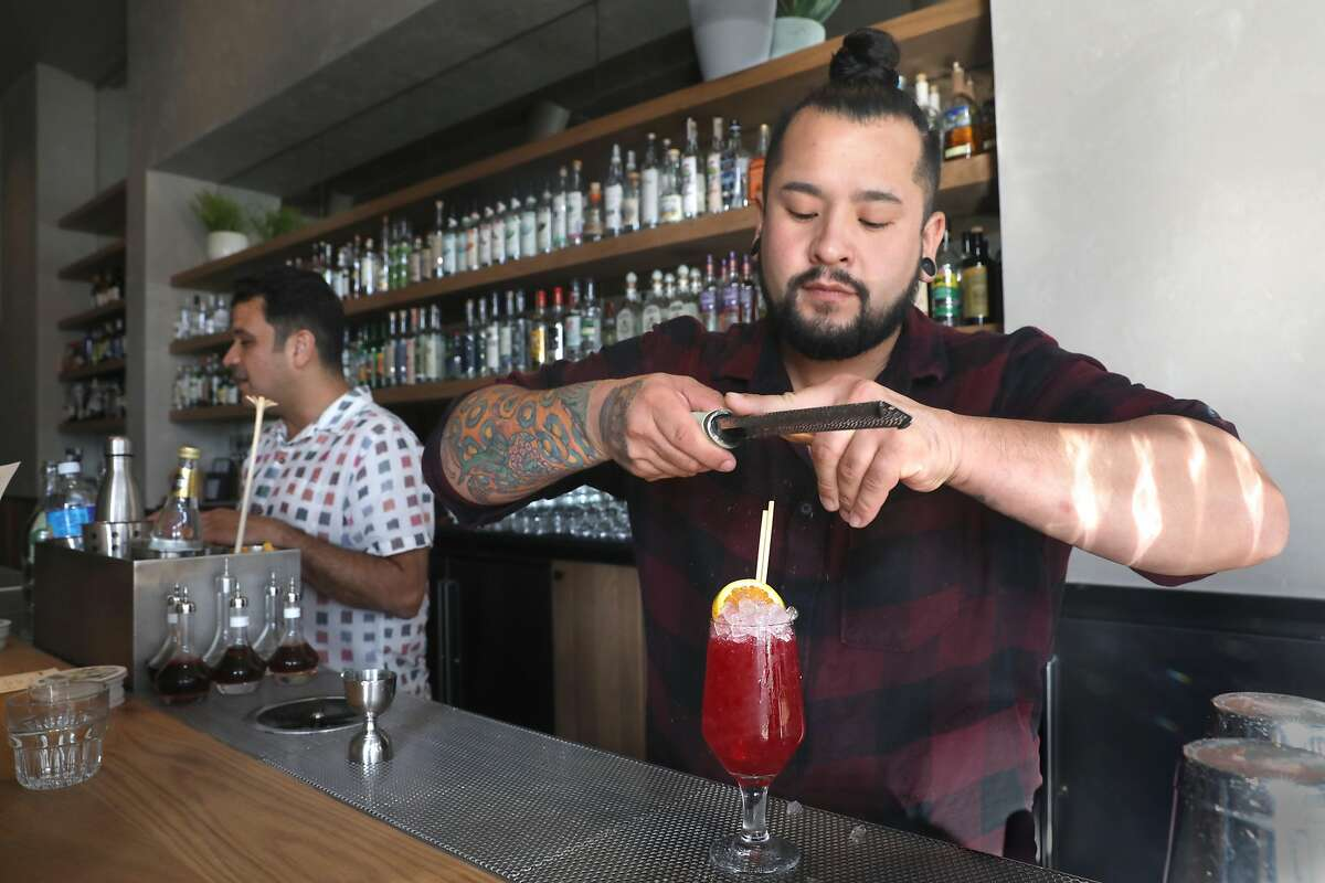Bartender Christian Suzuki makes a Vampiros cocktail�mezcal, vampire shrub, lemon, cinnamon�at Elda on Tuesday, Oct. 8, 2019, in San Francisco, Calif.